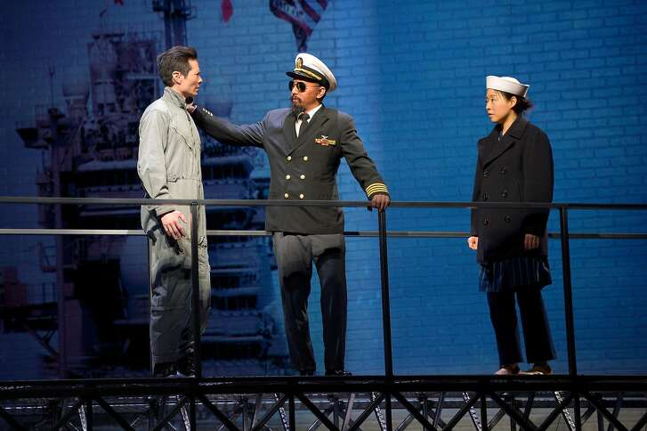 """Quang (James Seol, left), Captain Chambers (Jomar Tagatac, center) of the USS Midway and his translator (Cindy Im, right) in American Conservatory Theater's """"Vietgone."""""""