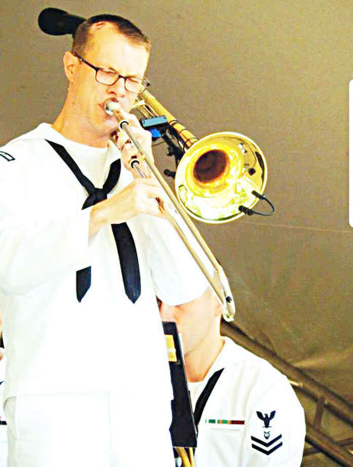 U.S. Navy Petty Officer 1st Class Zach Ellerbrook plays his trombone. Photo: For The Telegraph