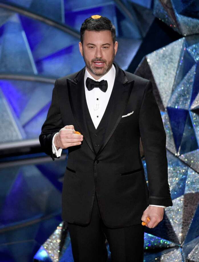 Host Jimmy Kimmel speaks at the Oscars on Sunday, March 4, 2018, at the Dolby Theatre in Los Angeles. (Photo by Chris Pizzello/Invision/AP) Photo: Chris Pizzello / 2018 Invision