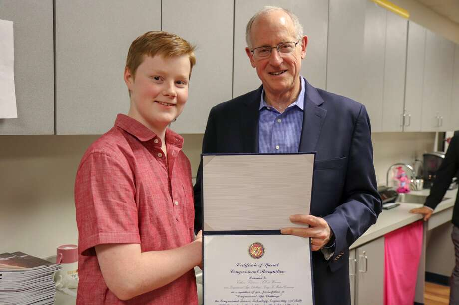 U.S. Rep. Mike Conaway visited Premier High School of Midland on Thursday to present an award to sophomore Ethan Thames as the 11th District's winner in the Congressional App Challenge. Photo: Courtesy Photo