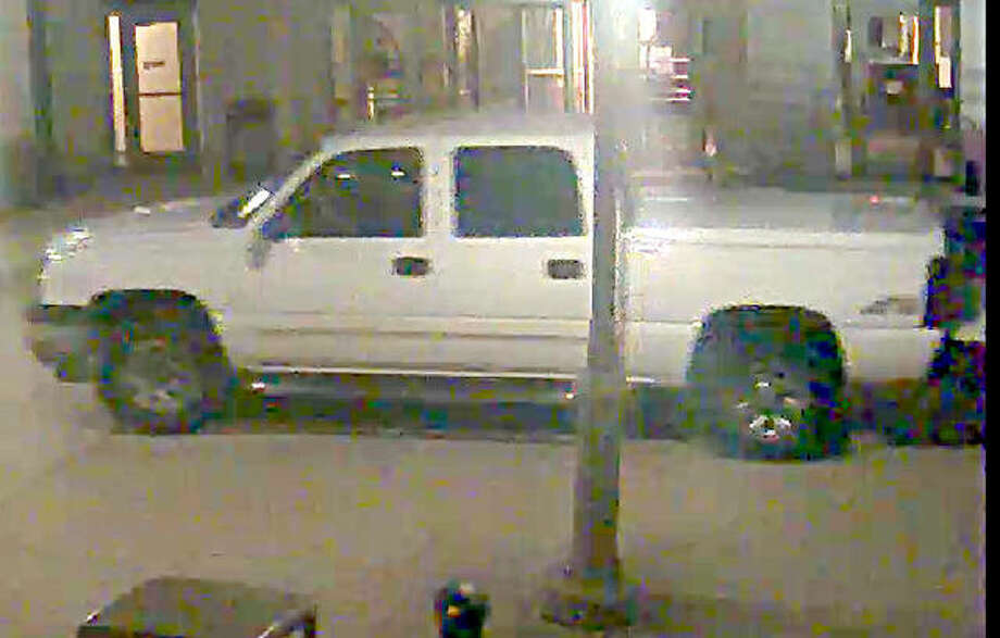 A surveillance camera captured the truck driving between the Madison County Courthouse and the Administration Building. Photo: For The Telegraph