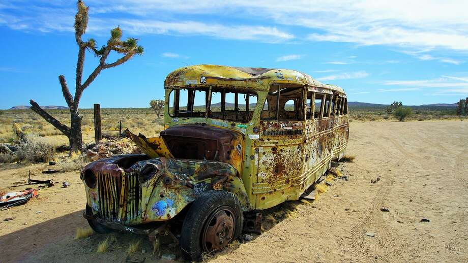 A dilapidated school bus by Mojave Road. Photo: Becky Wright/Flickr