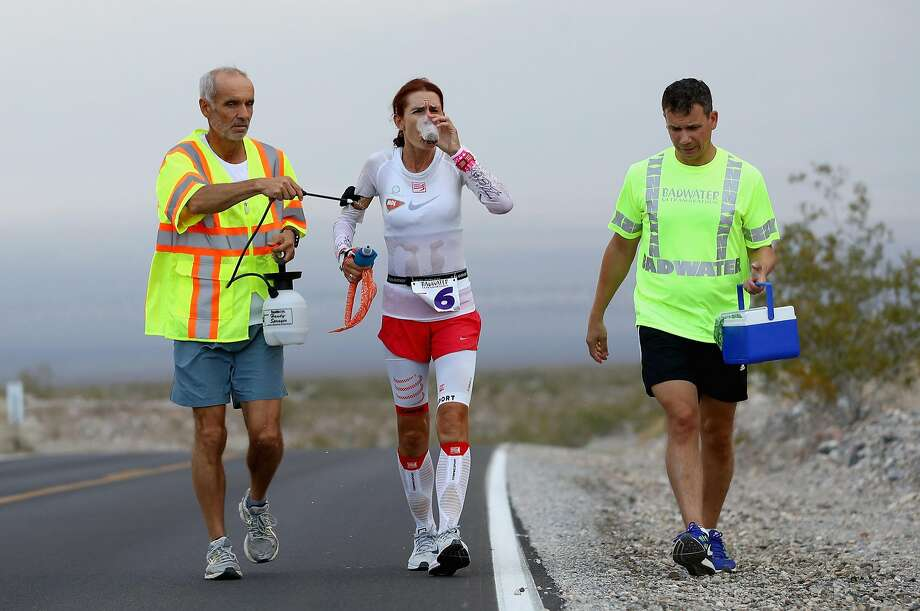 Szilvia Lubics, a competitor from Hungary, is sprayed by a member of her support crew during the Badwater Ultramarathon in July. Photo: Ezra Shaw, Getty Images