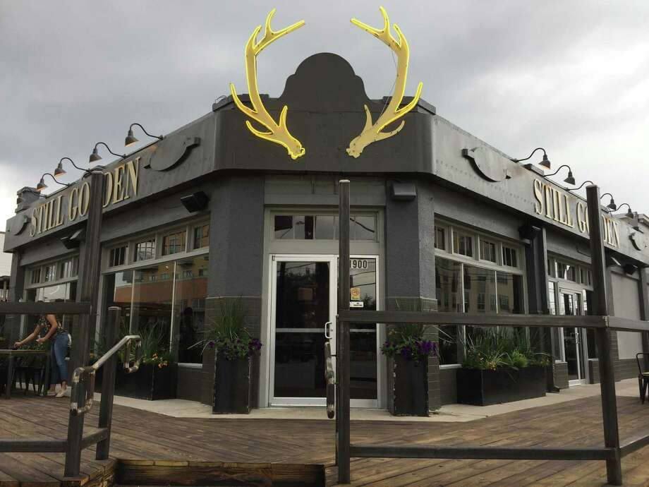 The antlered entry to Still Golden Social House is a new landmark on Broadway north of downtown. Photo: Paul Stephen /San Antonio Express-News