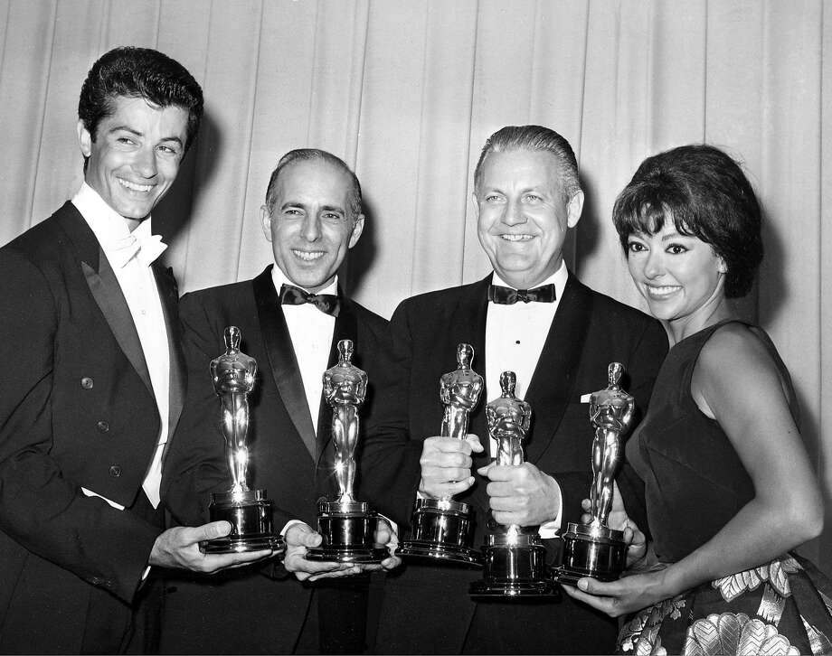 """In this April 9, 1962, file photo, Oscar winners for """"West Side Story,"""" from left, actor George Chakiris, co-directors Jerome Robbins and Robert Wise, and actress Rita Moreno, pose at the Academy Awards in Santa Monica. Photo: Associated Press"""