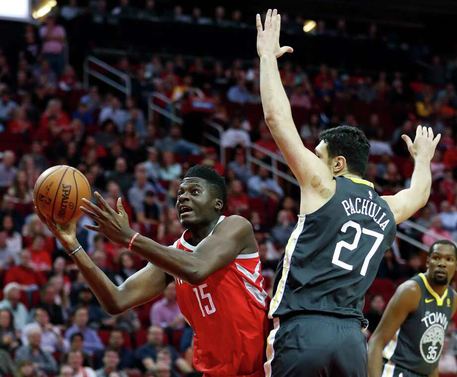 Houston Rockets center Clint Capela (15) shoots around the defense of Golden State Warriors center Zaza Pachulia (27) during the first quarter of an NBA basketball game at Toyota Center on Saturday, Jan. 20, 2018, in Houston. ( Brett Coomer / Houston Chronicle ) Photo: Brett Coomer, Staff / © 2018 Houston Chronicle