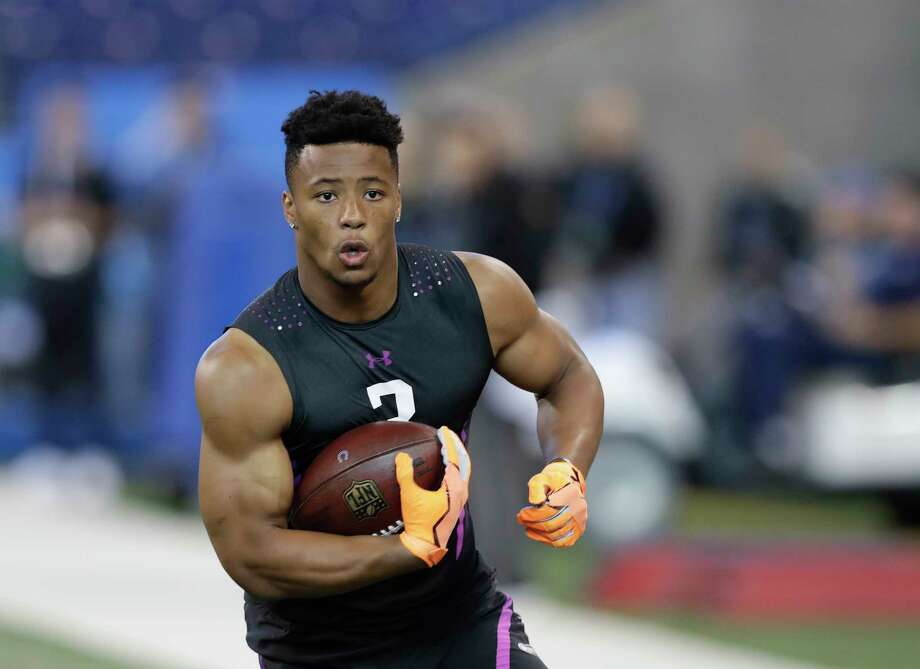 Penn State running back Saquon Barkley runs a drill during the NFL football scouting combine, Friday, March 2, 2018, in Indianapolis. (AP Photo/Darron Cummings).Browse through the slideshow to see McClain and Wilson's third mock drafts of the year. Photo: Darron Cummings, STF / Copyright 2018 The Associated Press. All rights reserved.