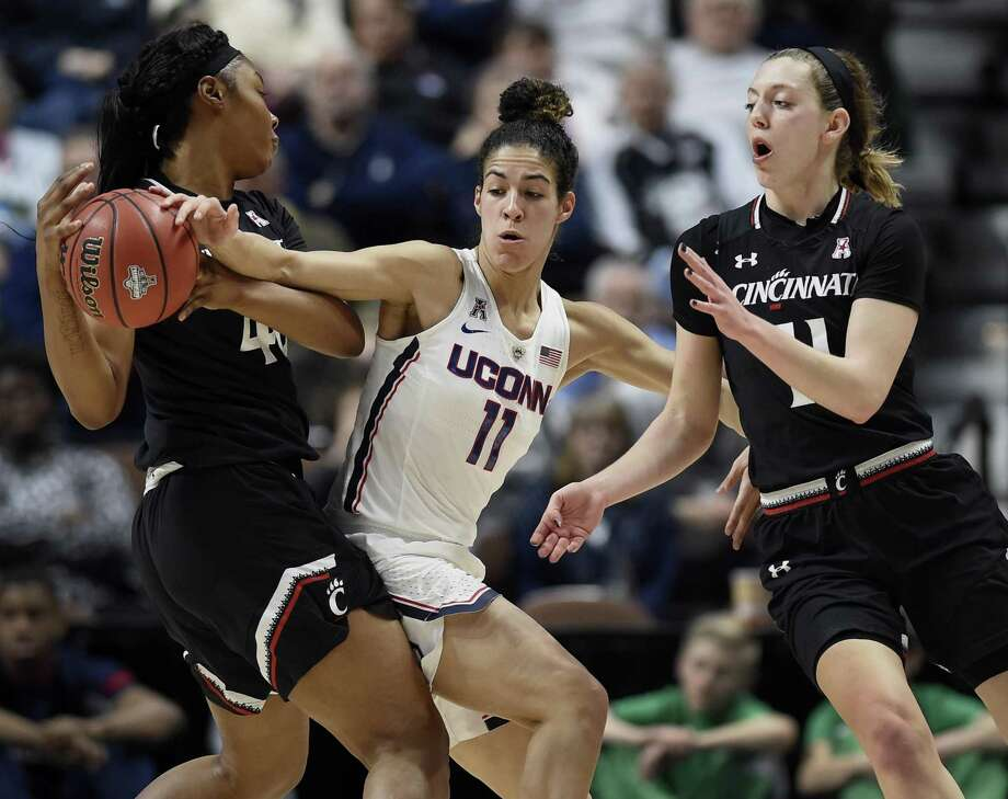 Cincinnati's Andeija Puckett, left, looks to pass while under pressure from UConn's Kia Nurse Monday in Uncasville. Photo: Jessica Hill / Associated Press / AP2018