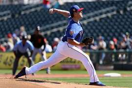 SURPRISE, AZ - MARCH 05:  Starting pitcher Matt Moore #55 of the Texas Rangers pitches against the San Francisco Giants during first inning of the spring training game at Surprise Stadium on March 5, 2018 in Surprise, Arizona.  (Photo by Christian Petersen/Getty Images)
