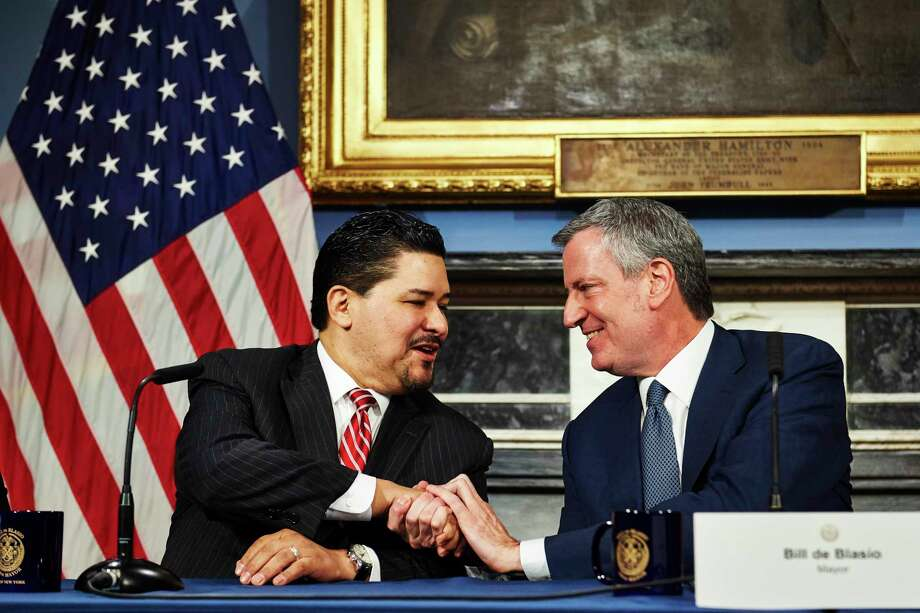 New York City Mayor Bill de Blasio, right, shakes hands with New York City Schools Chancellor Richard Carranza during a news conference at City Hall on Monday, March 5, 2018 in Manhattan, N.Y.   Carranza replaces outgoing Chancellor Carmen Fariña. Photo: James Keivom, New York Daily News / 2018/Daily News, L.P. (New York)