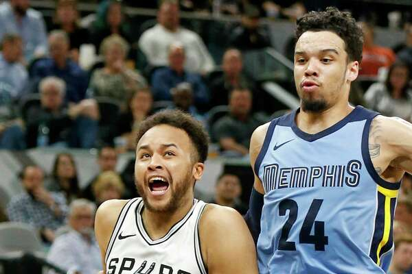 San Antonio Spurs forward Kyle Anderson (1) drives around Memphis Grizzlies forward Dillon Brooks (24) during first half action Monday March 5, 2018 at the AT&T Center.