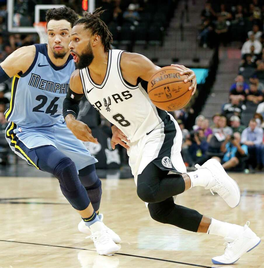 San Antonio Spurs guard Patty Mills (8) looks for room around Memphis Grizzlies forward Dillon Brooks (24) during first half action Monday March 5, 2018 at the AT&T Center. Photo: Edward A. Ornelas, San Antonio Express-News / © 2018 San Antonio Express-News
