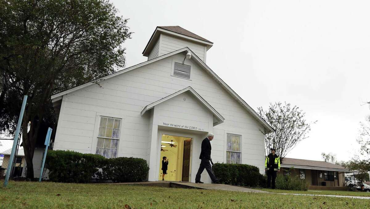 FILE - In this Nov. 12, 2017, file photo, a man walks out of the memorial for the victims of a shooting at First Baptist Church of Sutherland Springs. (AP Photo/Eric Gay, File)