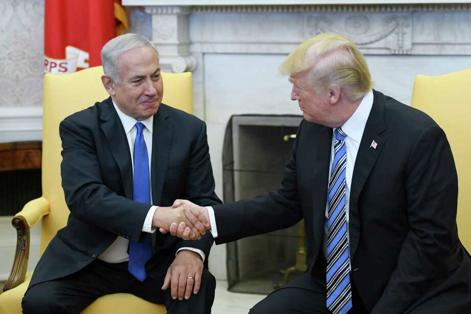 WASHINGTON, DC - MARCH 5: (AFP OUT) U.S. President Donald Trump (R) shakes hands withIsrael Prime Minister Benjamin Netanyahu as they meet in the Oval Office of the White House  March 5, 2018 in Washington, DC. The prime minister is on an official visit to the US until the end of the week. (Photo by Olivier Douliery-Pool/Getty Images) Photo: Pool / 2018 Getty Images