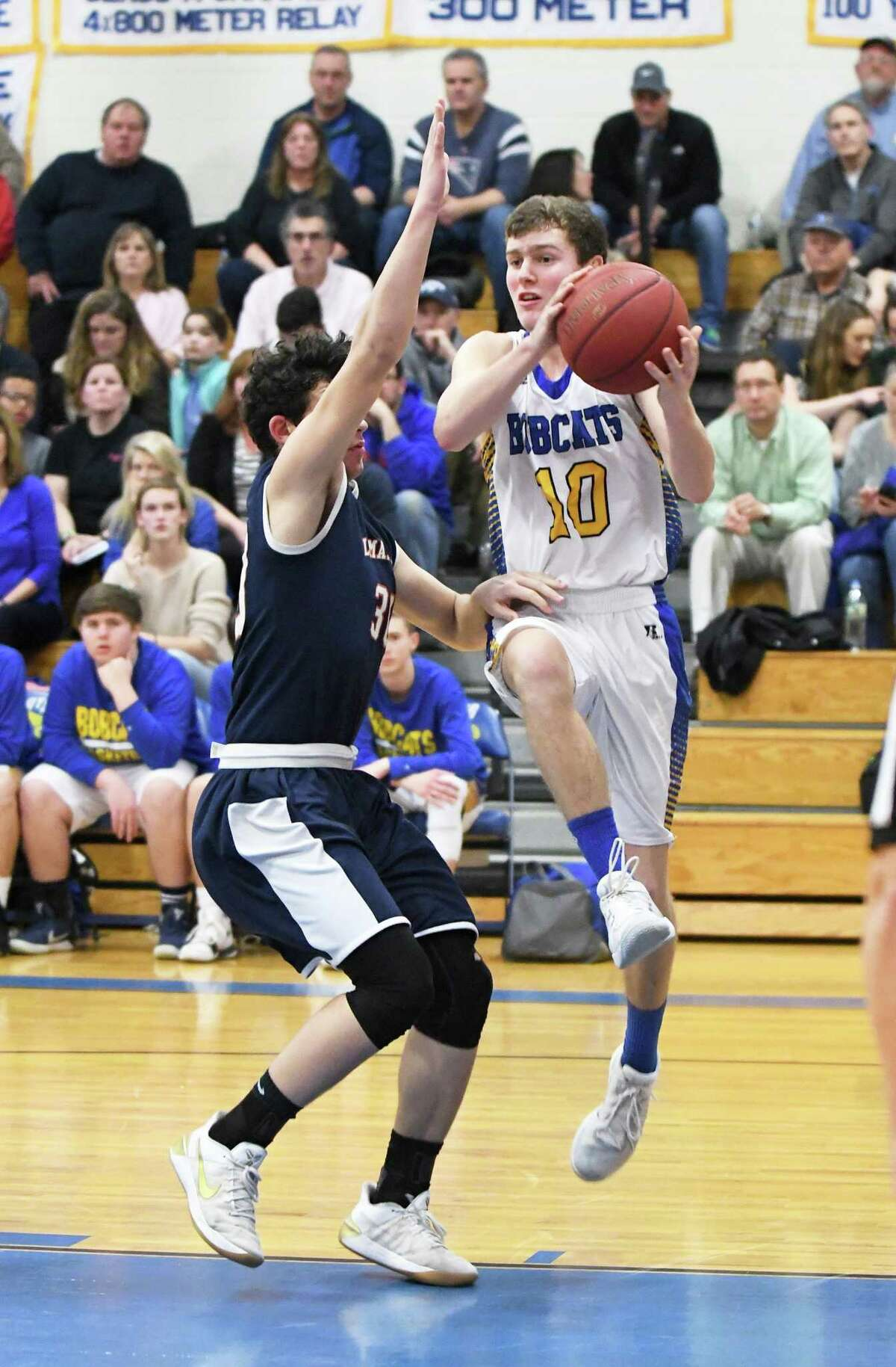 Brookfield?'s David Walker (10) right, looks past Lyman Hall?'s Luke O?'Reardon during the first round of the Division III boys basketball game between Brookfield and Lyman Hall at Brookfield, March 5, 2018.