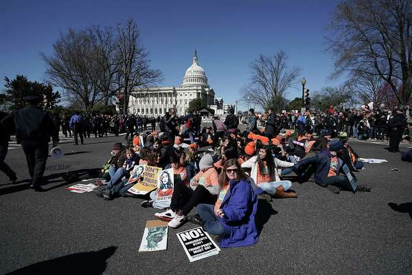 WASHINGTON, DC - MARCH 05:  Immigration activists stage a civil disobedience to shut down Independence Avenue March 5, 2018 on Capitol Hill in Washington, DC. Congress has not come up with a fix as today marks the deadline President Donald Trump has set to end The Deferred Action for Childhood Arrivals (DACA) program.  (Photo by Alex Wong/Getty Images)