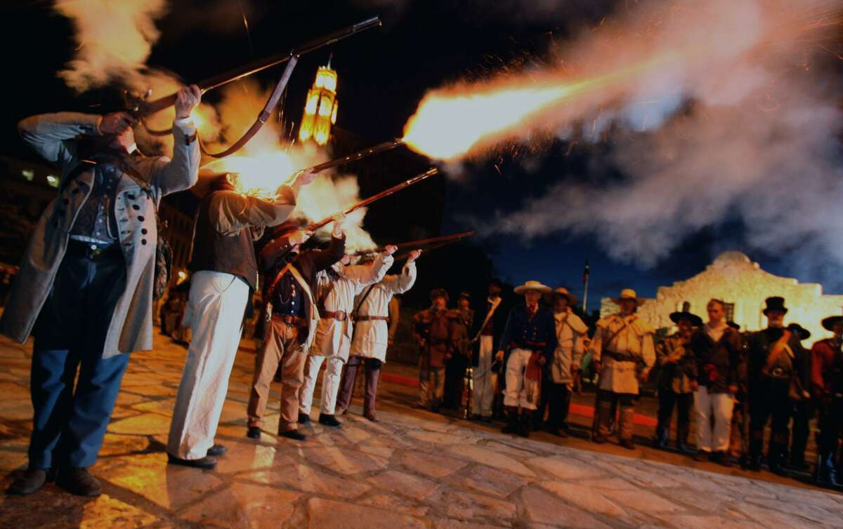 Members of the San Antonio Living History Association fire off a volley on the morning of March 6, 2007, in front of the Alamo. Re-enactors were there in period dress to mark the anniversary of the Battle of the Alamo.