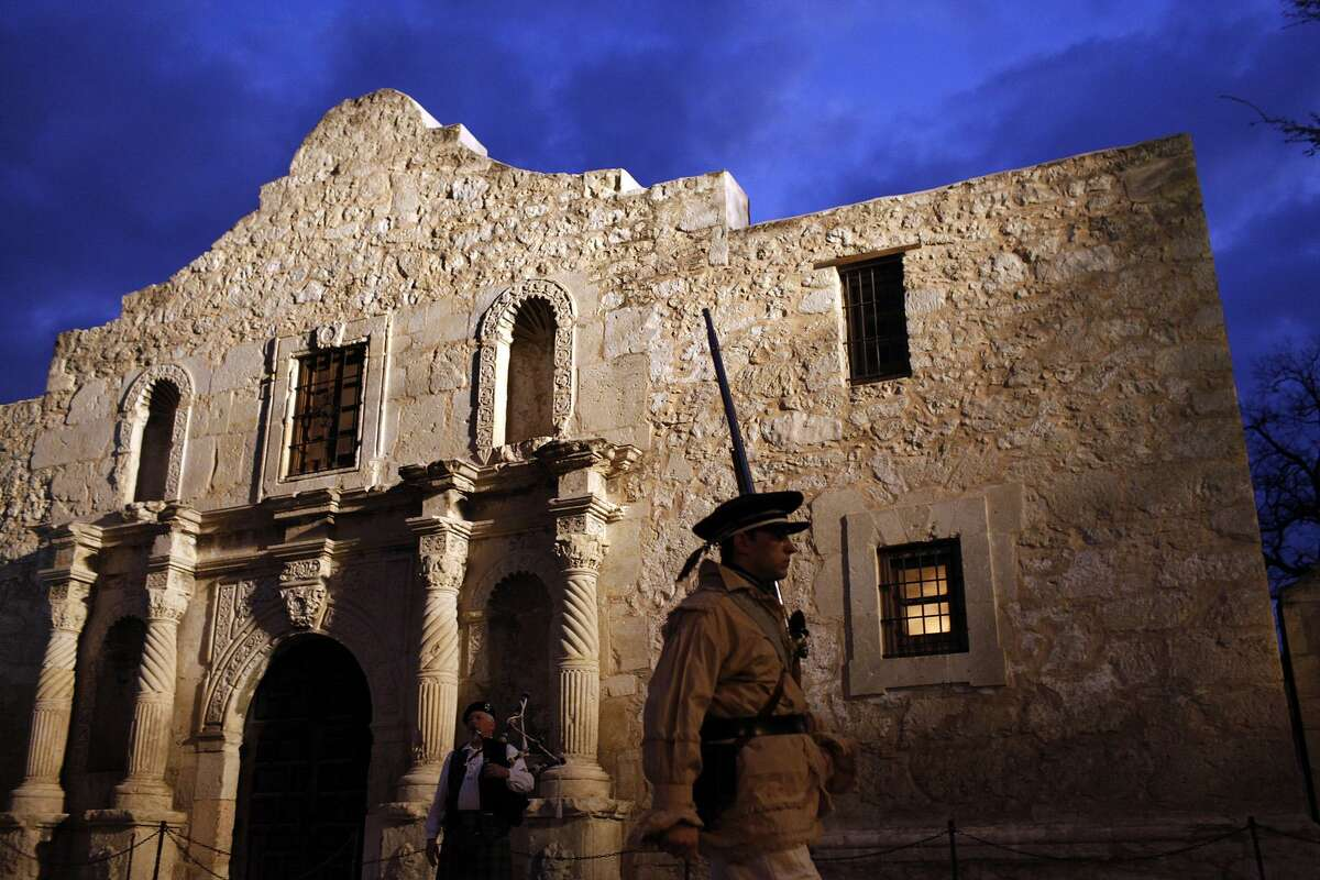 Kyle Duncan, a member of the San Antonio Living History Association, participates in the Dawn at the Alamo ceremony in San Antonio on March 6, 2009.