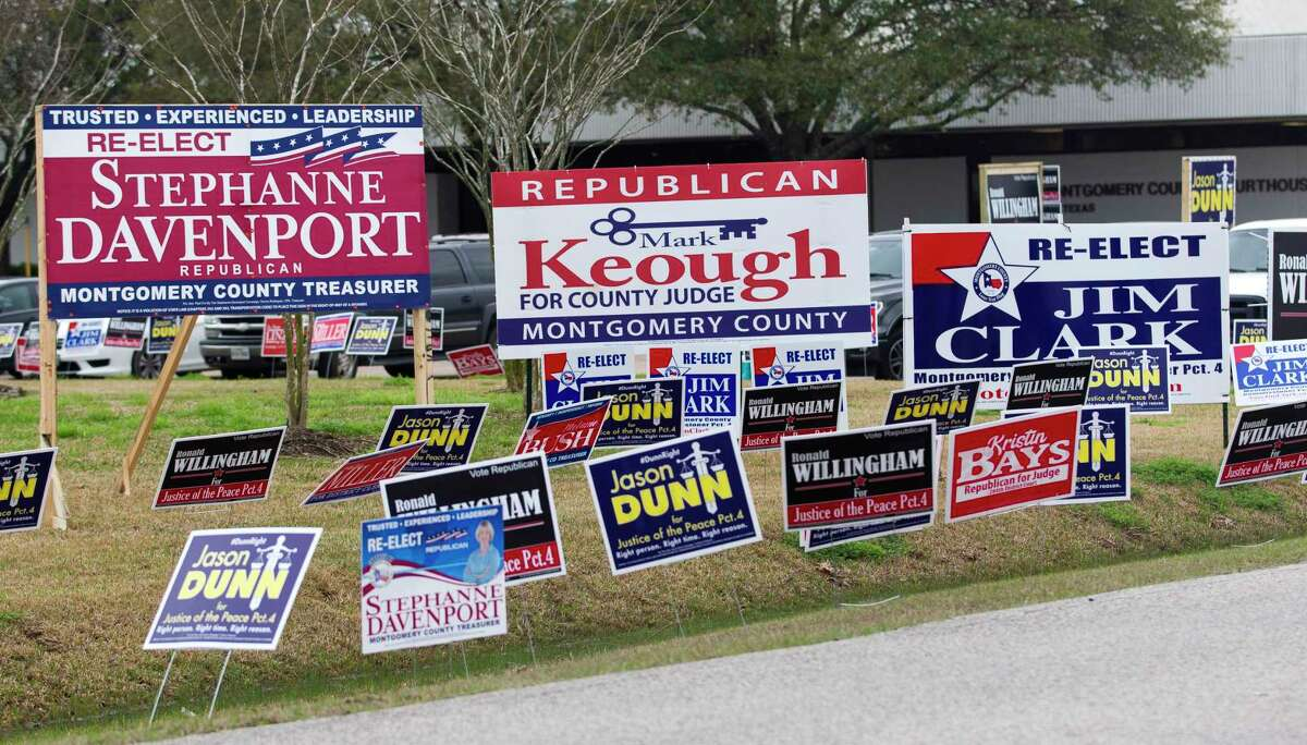 Political signs line the street to the East Montgomery County Courthouse on the first day of Early Voting, Tuesday, Feb. 20, 2018, in New Caney.