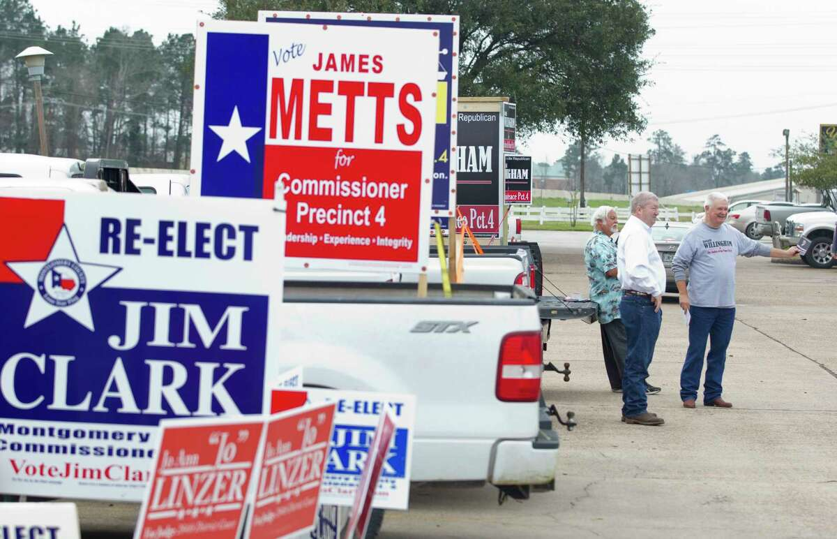 Incumbent Montgomery County Precinct 4 Commissioner Jim Clark, center, visits with challenger Bob Bagley, left, and Ronald Willingham, candidate for Montgomery County Precinct 4 Justice of the Peace, on the first day of Early Voting at the East Montgomery County Courthouse, Tuesday, Feb. 20, 2018, in New Caney.