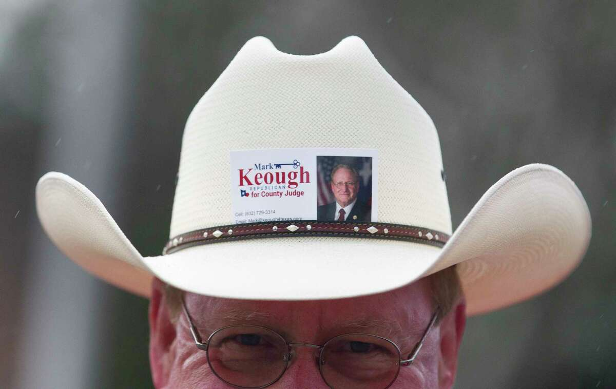The cowboy hat of Mark Keough, Republican candidate for Montgomery County Judge, is seen during early voting at the South County Community Building, Saturday, Feb. 24, 2018, in The Woodlands.
