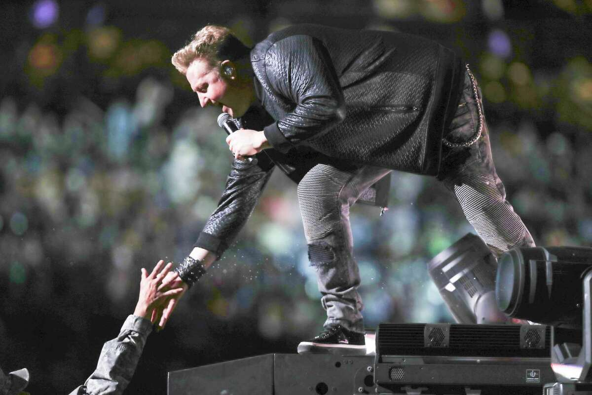 Rascal Flatts, Gary LeVox, gives High-Fives to First Responders as they performed at Rodeo Houston Monday, March 5, 2018, in Houston.