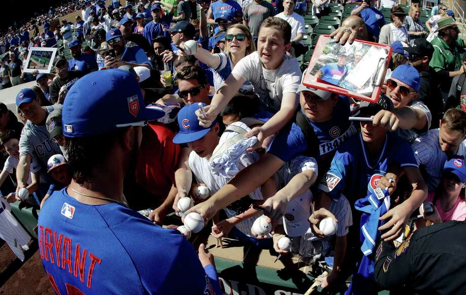 Fans try for a autograph from Chicago Cubs third baseman Kris Bryant before a spring baseball game against the Colorado Rockies in Scottsdale, Ariz., Monday, March 5, 2018. (AP Photo/Chris Carlson) Photo: Chris Carlson / Copyright 2018 The Associated Press. All rights reserved.
