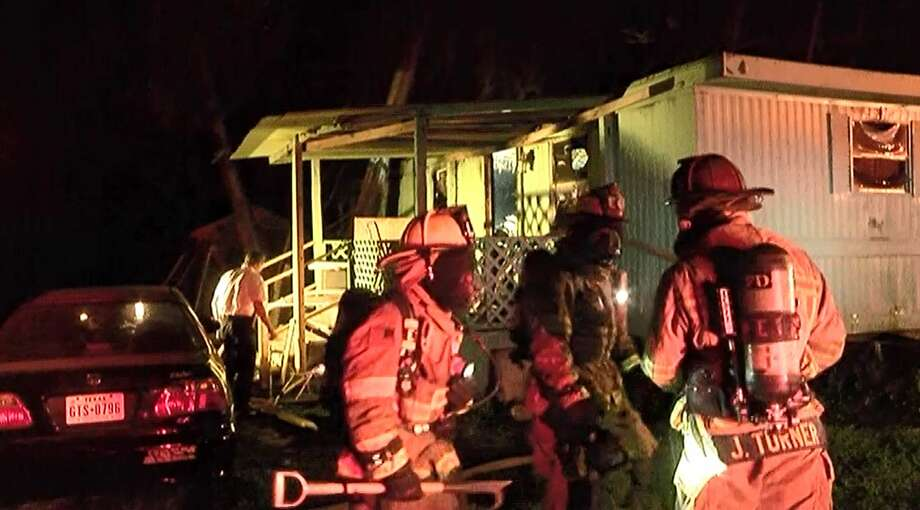 Conroe firefighters were called out to the fire in the 300 block of Porter Road just south of East Davis Street at the Pine Crest Mobile Home Park around 9 p.m. As firefighters entered the home, they found a man inside who required CPR Photo: Scott Engle / Montgomery County Police Reporter