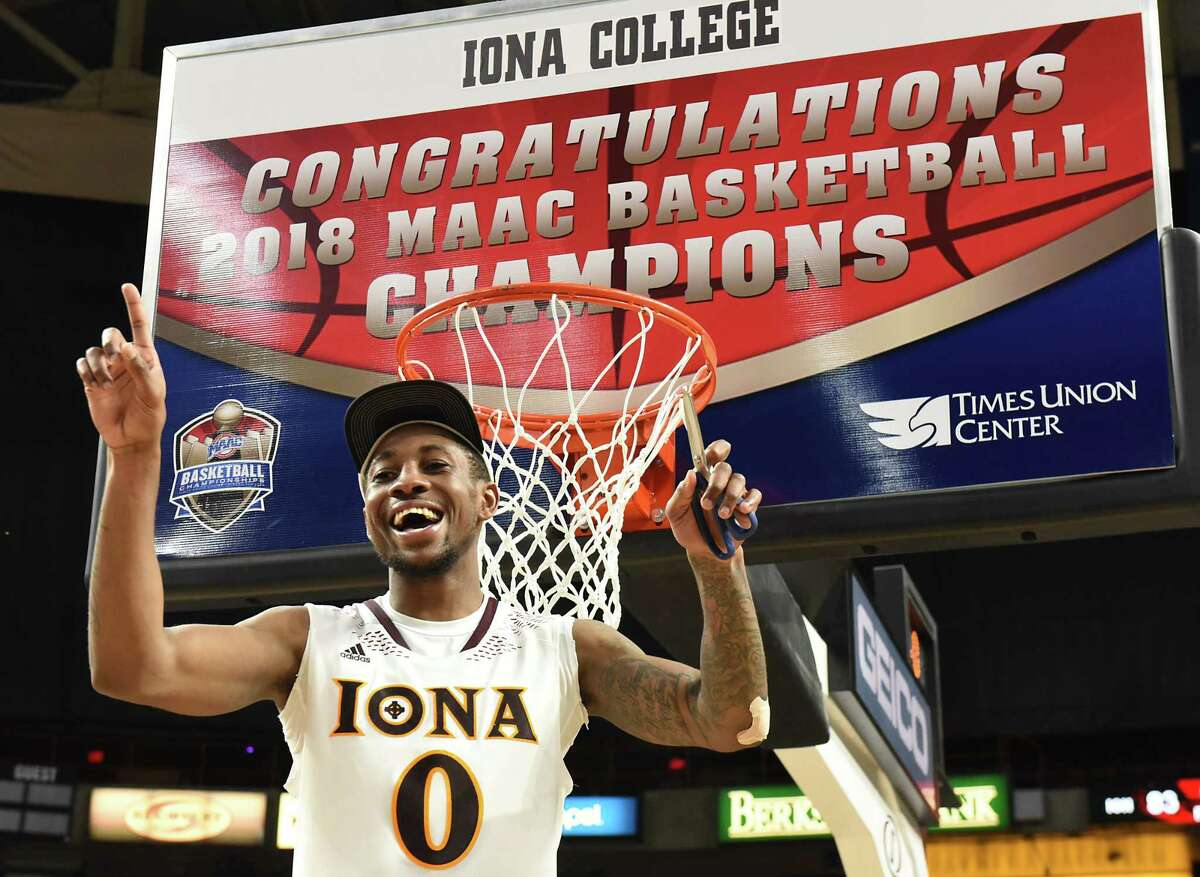 Iona's Ricky McGill cuts a piece of net as he and his team celebrates after defeating Fairfield in the Metro Atlantic Athletic Conference Tournament's championship game at the Times Union Center on Monday, March 5, 2018 in Albany N.Y. (Lori Van Buren/Times Union)
