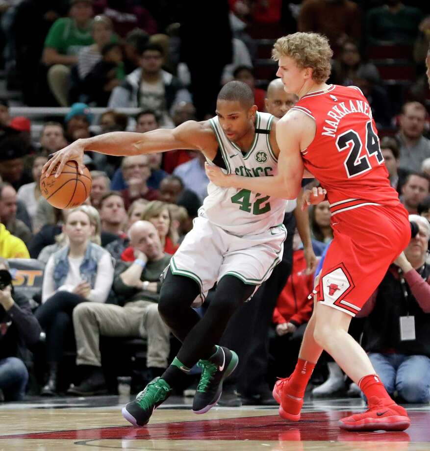 Boston Celtics' Al Horford (42) backs into the basket as Chicago Bulls' Lauri Markkanen defends during the first half of an NBA basketball game Monday, March 5, 2018, in Chicago. (AP Photo/Charles Rex Arbogast) Photo: Charles Rex Arbogast / Copyright 2018 The Associated Press. All rights reserved.