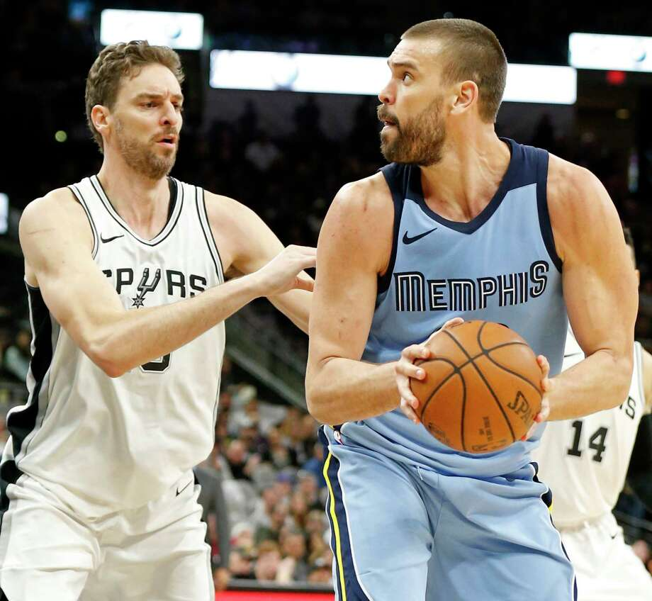 San Antonio Spurs center Pau Gasol (16) defends Memphis Grizzlies center Marc Gasol (33) during second half action Monday March 5, 2018 at the AT&T Center. Photo: Edward A. Ornelas, San Antonio Express-News / © 2018 San Antonio Express-News