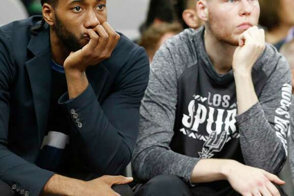 San Antonio Spurs forward Kawhi Leonard (2) and center Davis Bertans (42) watch first half action against the Memphis Grizzlies from the bench Monday March 5, 2018 at the AT&T Center.