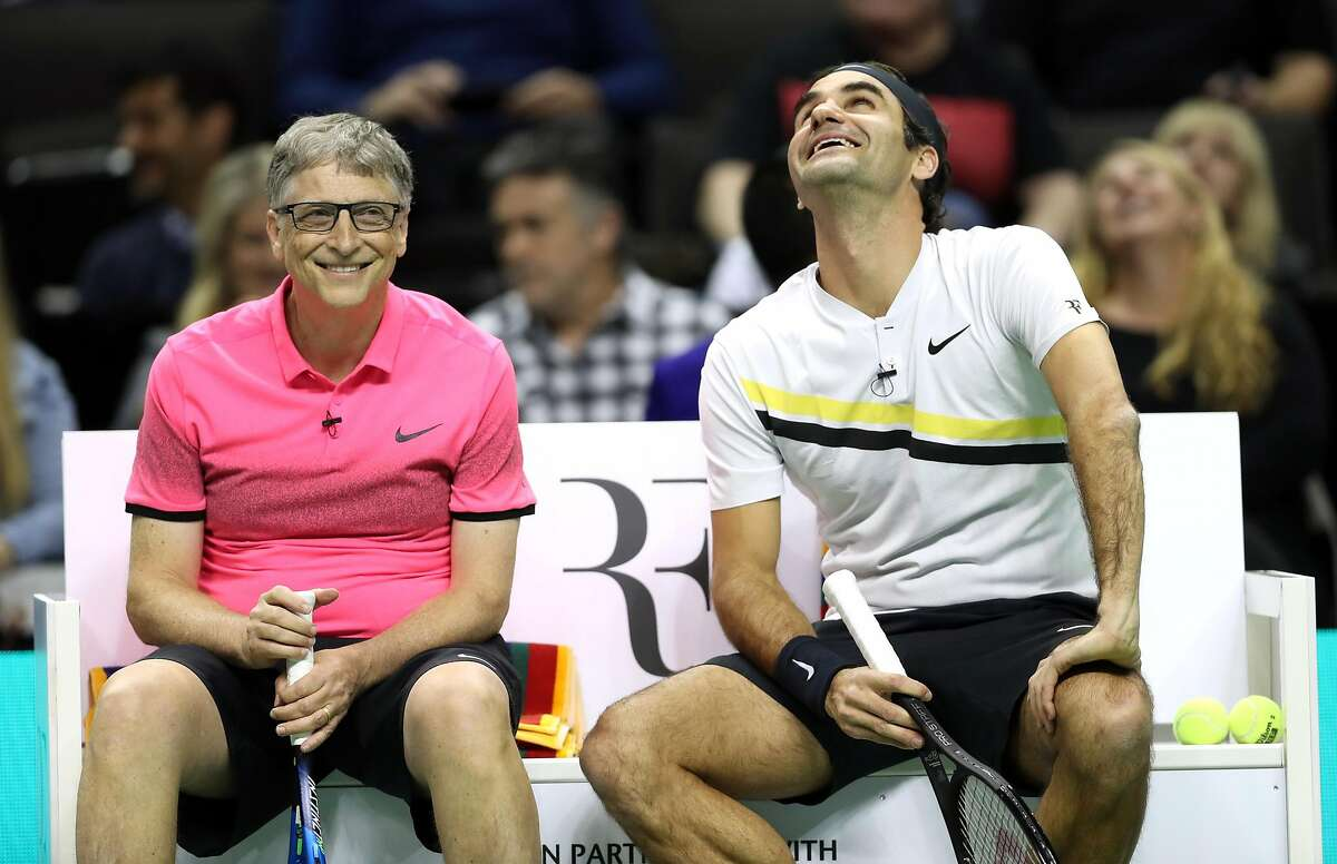 Bill Gates and Roger Federer wait to take on Jack Sock and Savannah Guthrie during the pro/celebrity doubles tennis match during The Match for Africa at the SAP Center in San Jose, Calif., on Monday, March 5, 2018.