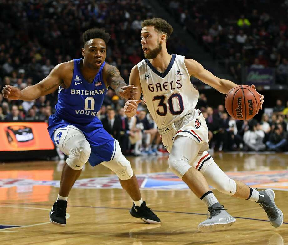 LAS VEGAS, NV - MARCH 05:  Jordan Ford #30 of the Saint Mary's Gaels drives against Jahshire Hardnett #0 of the Brigham Young Cougars during a semifinal game of the West Coast Conference basketball tournament at the Orleans Arena on March 5, 2018 in Las Vegas, Nevada.  (Photo by Ethan Miller/Getty Images) Photo: Ethan Miller, Getty Images