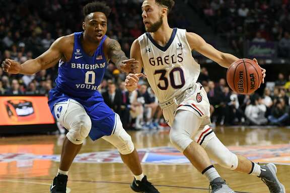 LAS VEGAS, NV - MARCH 05:  Jordan Ford #30 of the Saint Mary's Gaels drives against Jahshire Hardnett #0 of the Brigham Young Cougars during a semifinal game of the West Coast Conference basketball tournament at the Orleans Arena on March 5, 2018 in Las Vegas, Nevada.  (Photo by Ethan Miller/Getty Images)