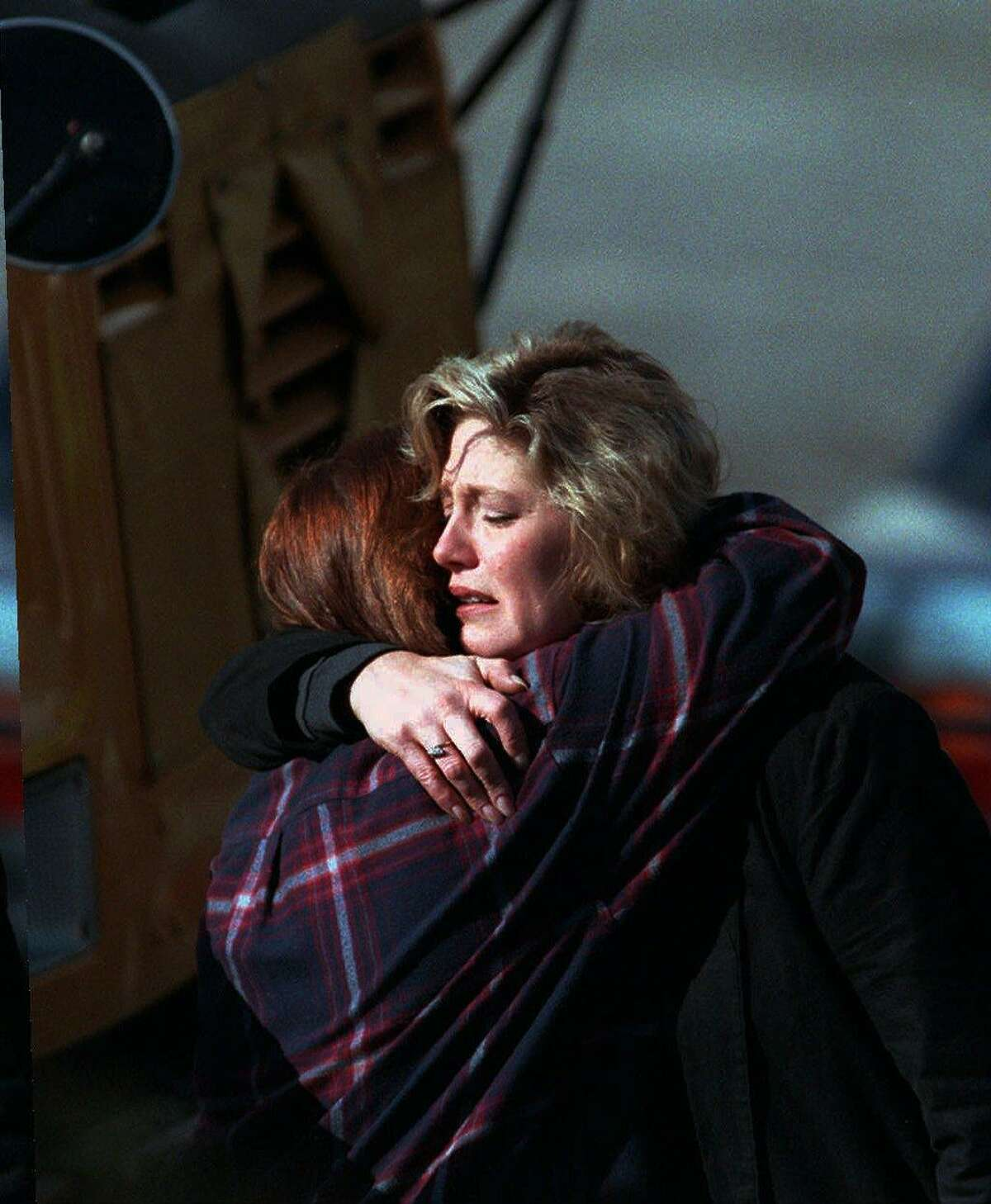 State lottery workers comfort each other outside Connecticut Lottery headquarters in Newington on March 6, 1998, after a lottery employee shot four people to death and then turned the gun on himself.