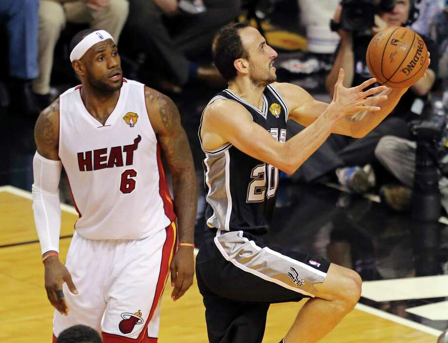 After a heartbreaking Finals loss the previous year, Manu Ginobili and the Spurs blew past the Heat in their 2014 rematch. Photo: Edward A. Ornelas, San Antonio Express-News / © 2014 San Antonio Express-News