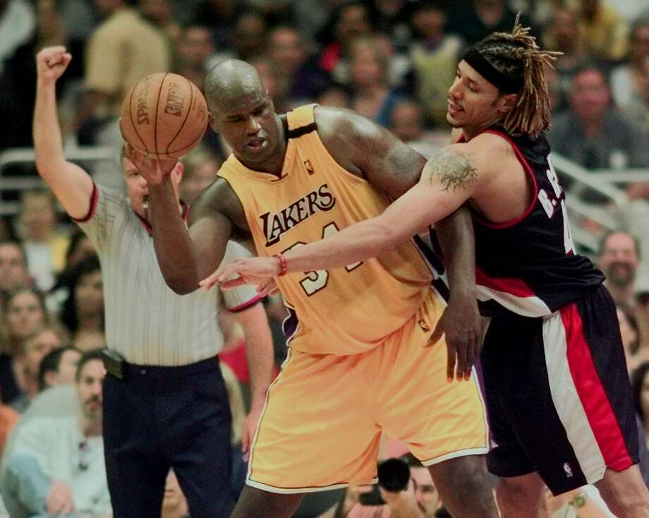 The first championship season of Shaquille O'Neal's career included two winning streaks of 16 games or more. Photo: MARK J TERRILL, AP / AP