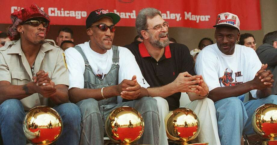 It can be argued that no championship team was more dominant from start to finish than the 1995-96 Bulls featuring the likes of (from left), Dennis Rodman, Scottie Pippen, coach Phil Jackson and Michael Jordan. Photo: BETH A. KEISER, AP / AP