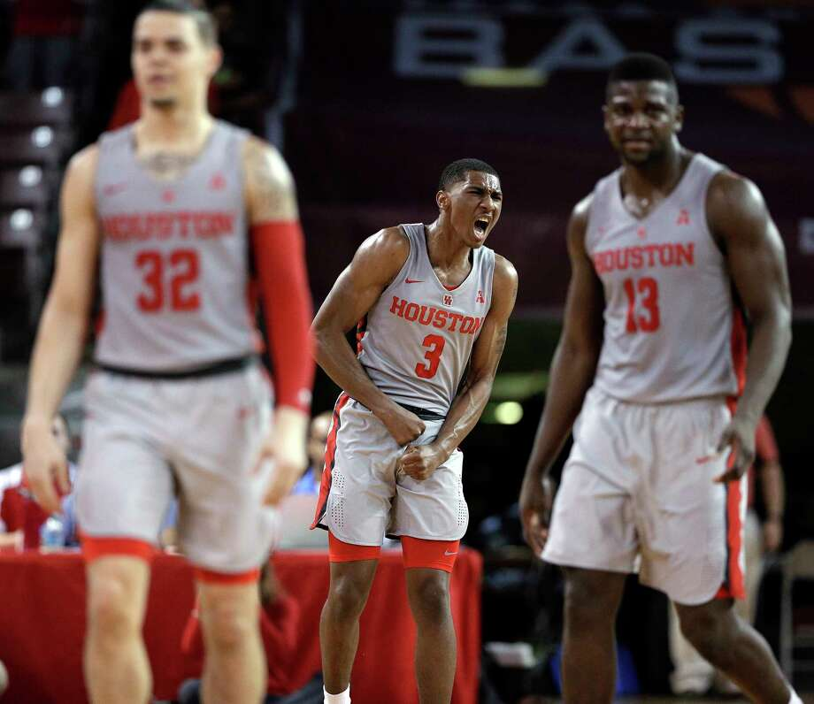 Houston guard Armoni Brooks (3) reacts after making a 3-point shot as guard Rob Gray (32) and forward Nura Zanna (13) head for the bench during a timeout in the second half of the team's NCAA college basketball game against Cincinnati on Thursday, Feb. 15, 2018, in Houston. (AP Photo/Michael Wyke) Photo: Michael Wyke, Associated Press / © Associated Press 2017