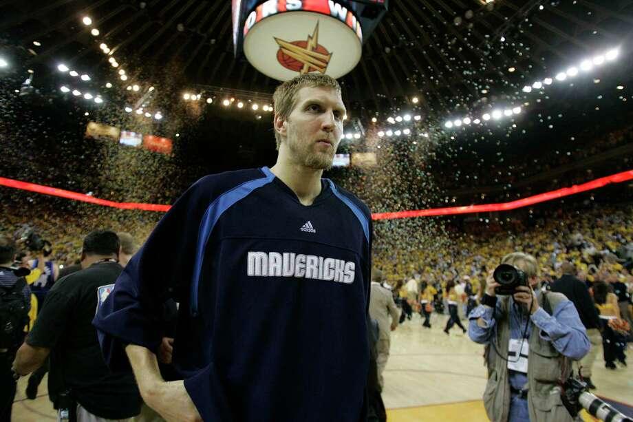 Dirk Nowitzki and the 2006-07 Mavericks made history of the ignominious type to end the 2006-07 season. Photo: Marcio Jose Sanchez, AP / AP