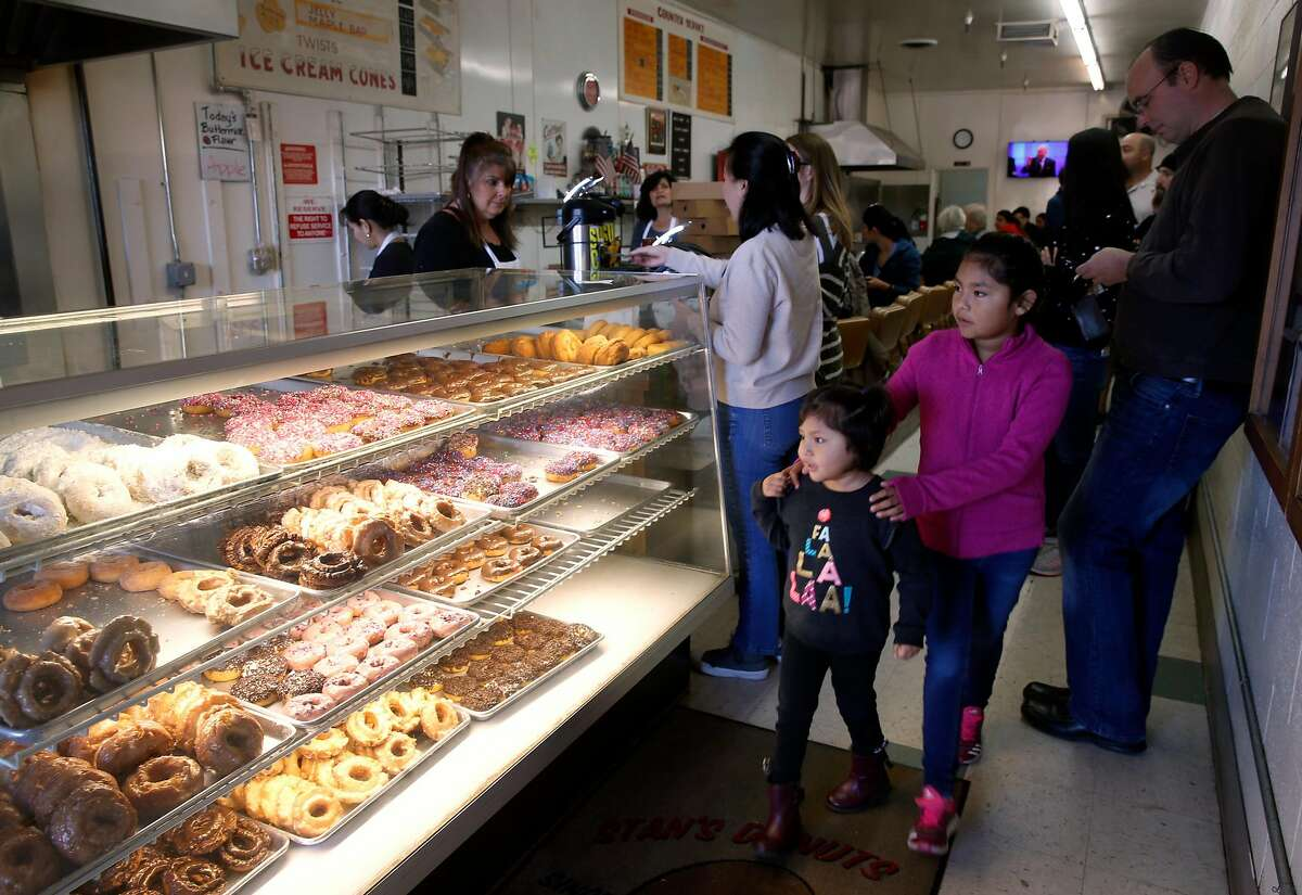 An assortment of fresh doughnuts are displayed at Stan's Donuts in Santa Clara, Calif. on Friday, Feb. 23, 2018.