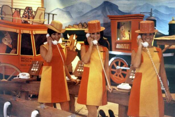 Guides in mini-dresses work the phones at HemisFair '68.
