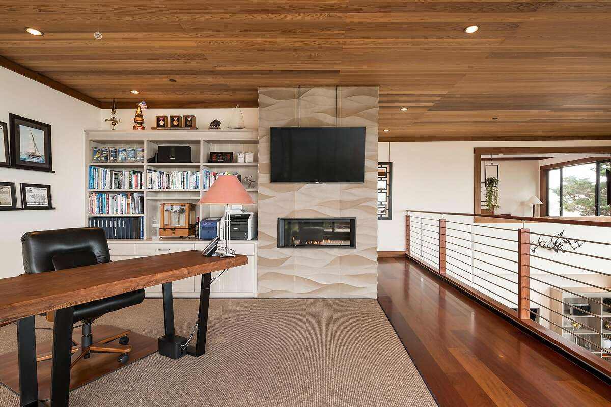 The third floor office includes a fireplace and built-in shelving.