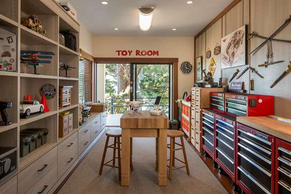 The guest toy room boasts floor-to-ceiling built-ins.