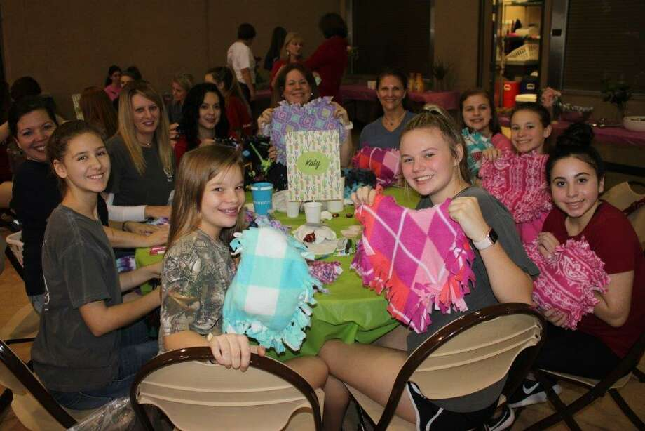 More than 400 teens and their mothers made pillows for nonprofits on Saturday as part of the National Charity League Inc. National Philanthropy Initiative. Above are members of the Katy chapter. Other Katy-area chapters are Lady Bird, Azalea and Star. Photo: Janette Gill