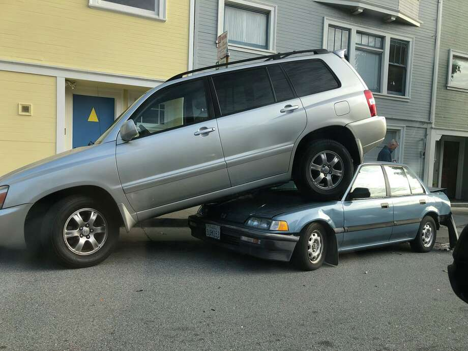 Two cars were stacked on top of each other following a hit and run. Photo: Photo By Sharky Laguana