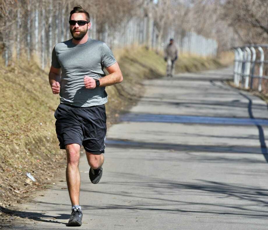 Nathan Graber of Rotterdam appreciates today's sunshine as he takes his daily run through the Corning Preserve  Tuesday March 6, 2018 in Albany, NY. Grader expects to be running tomorrow whatever the weather. (John Carl D'Annibale/Times Union) Photo: John Carl D'Annibale, Albany Times Union