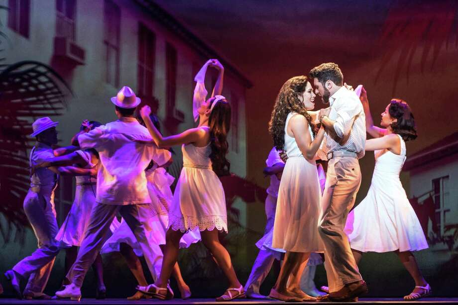 "Christie Prades and Mauricio Martinez play Gloria and Emilio Estefan in ""On Your Feet!"", a jukebox musical about the Estefans and their music. Photo: Courtesy Matthew Murphy /"