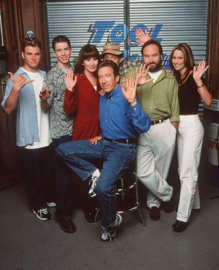 File photo of the cast of Home Improvement, left to right: Zachery Ty Bryan, Taran Smith, Patricia Richardson, Tim Allen, Richard Karn, Earl Hindman (in rear) and Debbe Dunning.)  Photo: Touchstone Television
